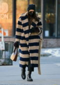 Irina Shayk stays warm in a full-length striped coat as she steps out to pick up her daughter in New York City