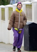 Iris Law bundles up in quirky attire while out with her boyfriend in London, UK
