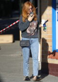 Isla Fisher dons a tiger print sweatshirt while out for a coffee in Sydney, Australia