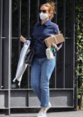 Isla Fisher indulges in some retail therapy on the eve of her 45th birthday while out in Sydney, Australia