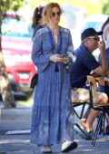 Isla Fisher looks lovely in a patterned blue dress while making a coffee run in Eastern Suburbs, Sydney, Australia