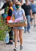 Isla Fisher struggles to carry her Valentine's Day essentials after grocery shopping at Rose Bay in Sydney, Australia