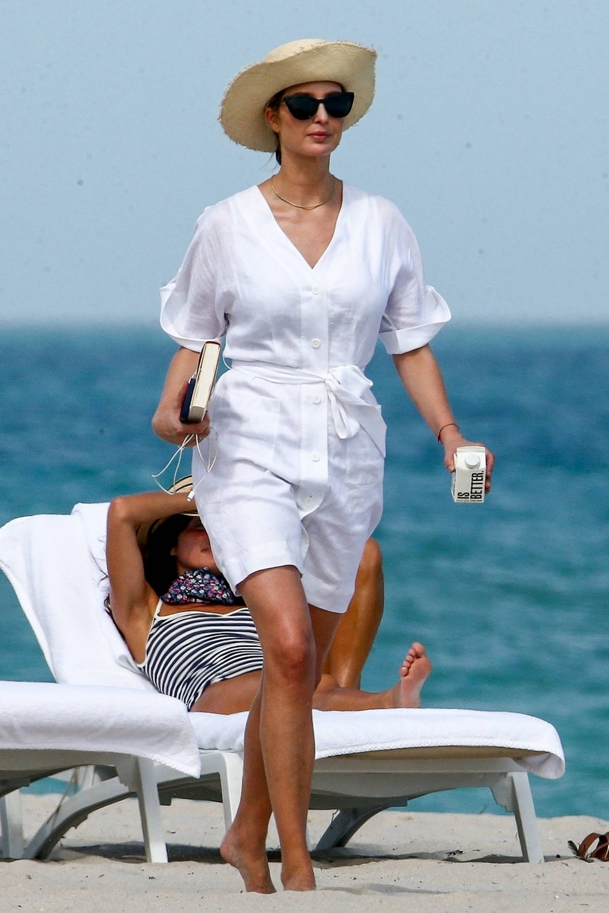 Ivanka Trump and Jared Kushner enjoy a romantic stroll on the beach while out soaking up the sun in Miami Beach, Florida