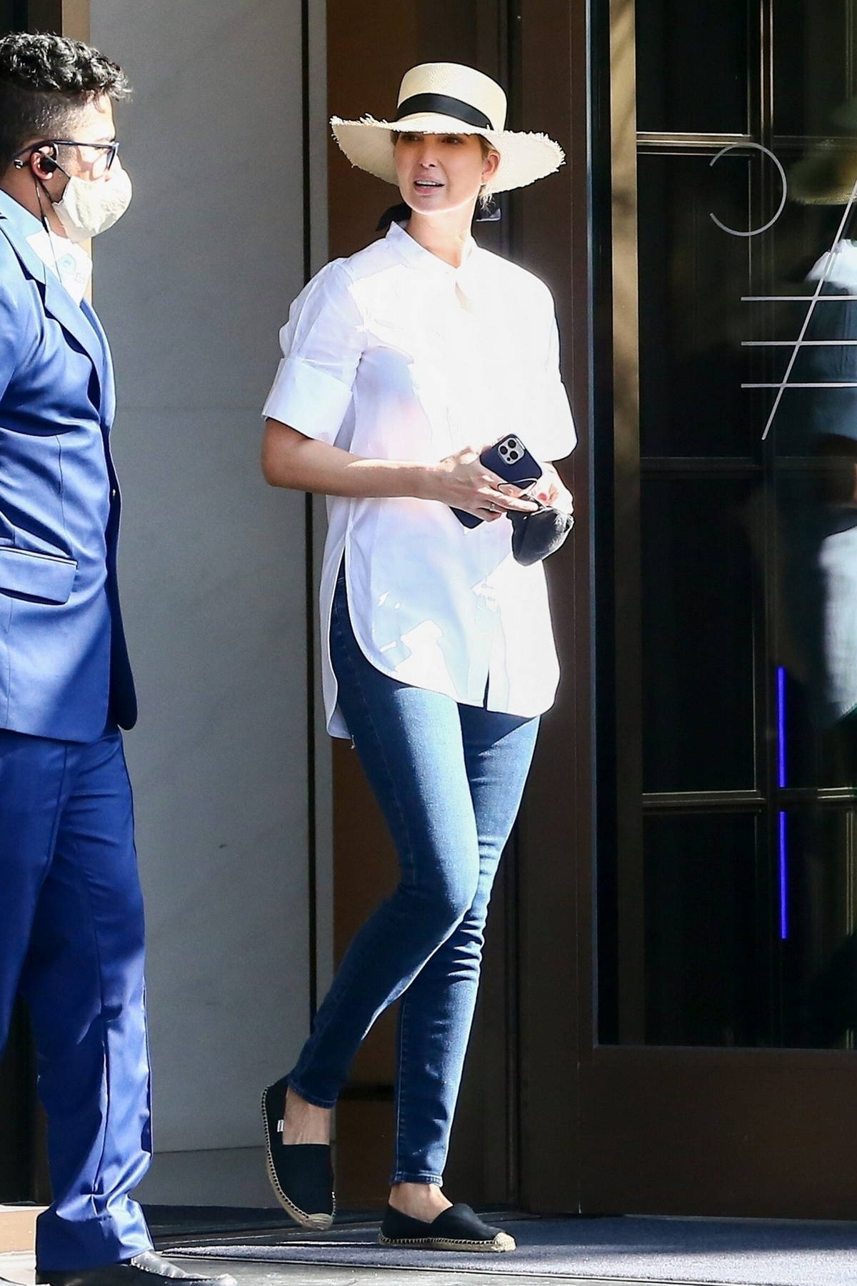 Ivanka Trump looks great in a white shirt and blue jeans as she leaves her luxury condo in Miami, Florida