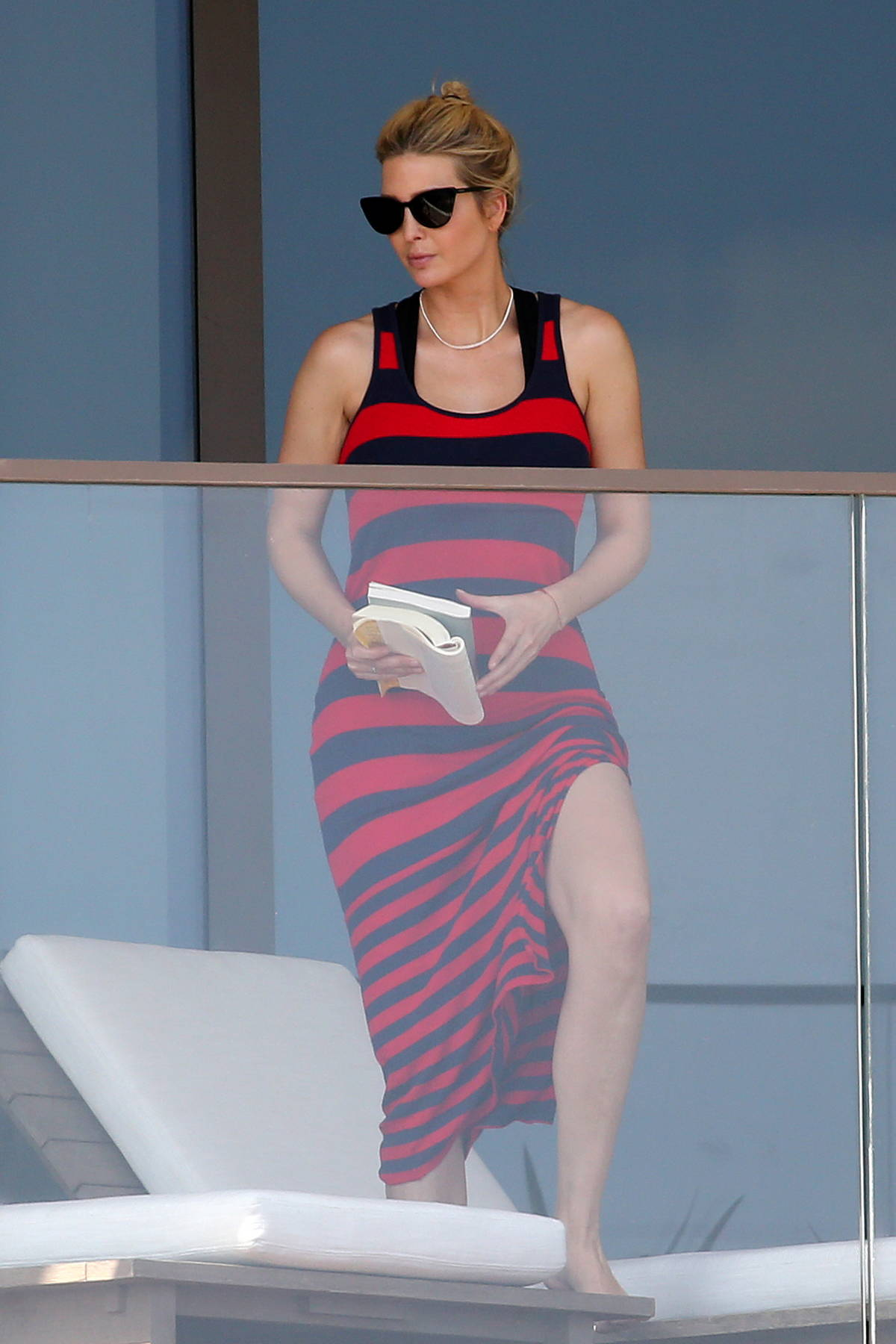 Ivanka Trump seen wearing a red and black striped dress while lounging on her balcony in Miami, Florida