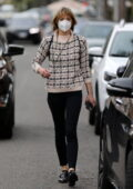 Jaime King wears a knitted sweater and black skinny jeans while out and about in Beverly Hills, California