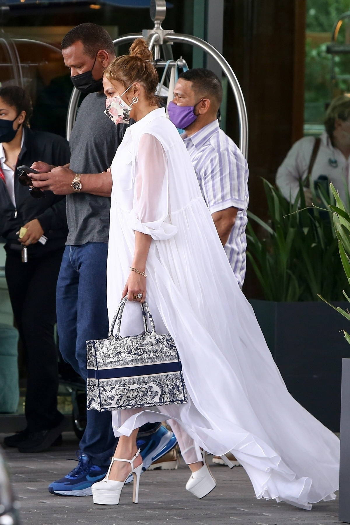 Jennifer Lopez looks great in a white dress as she and Alex Rodriguez leaves Mr C Coconut Grove Hotel in Miami, Florida