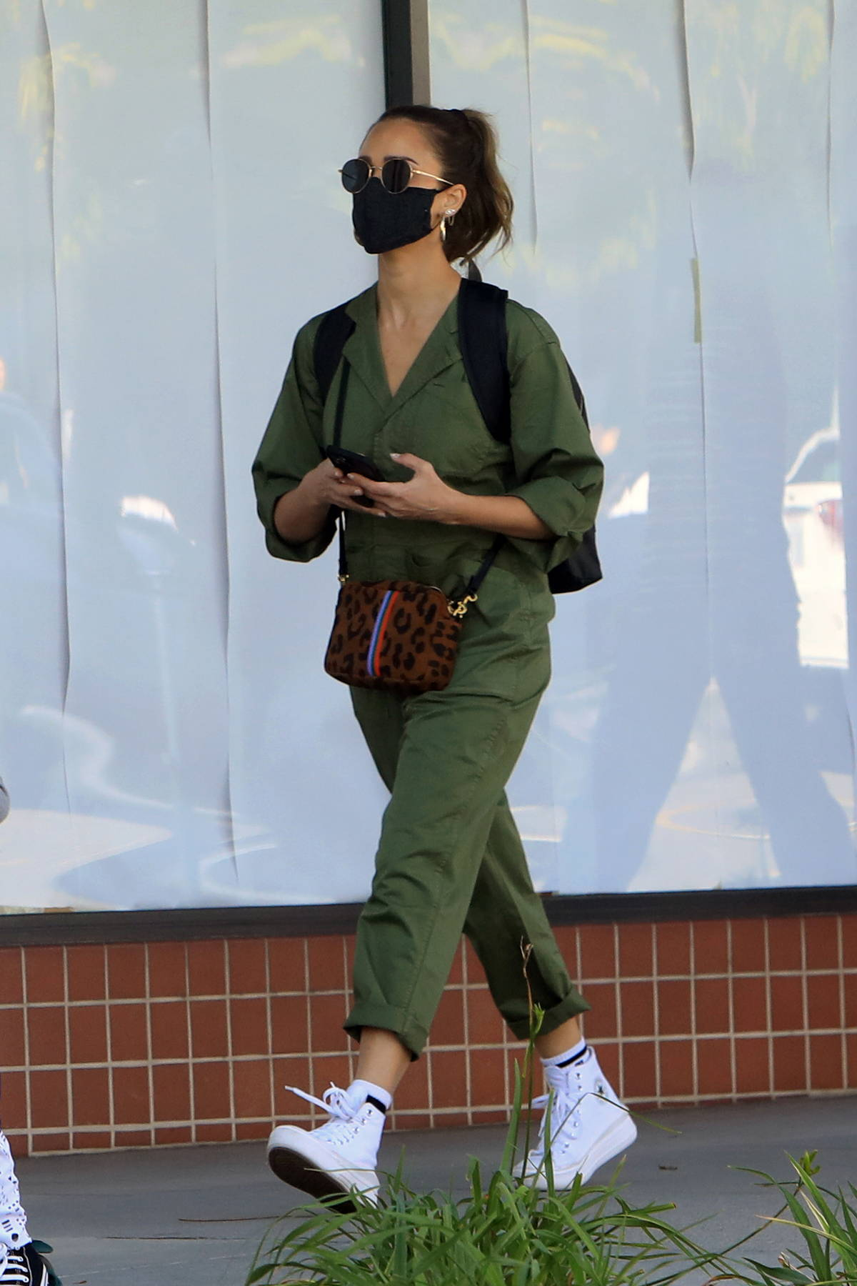 Jessica Alba looks great in a green jumpsuit while out with her family in Los Angeles