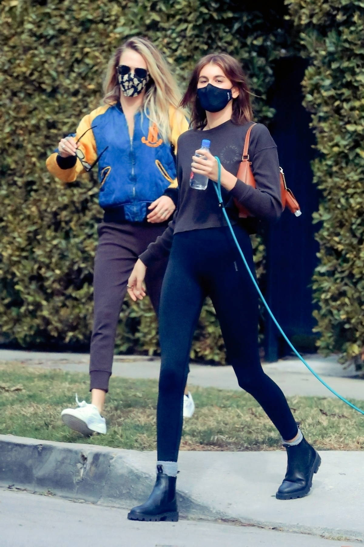 Kaia Gerber and Cara Delevingne seen leaving after their morning Pilates class in Los Angeles