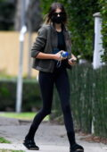 Kaia Gerber sports black crop top and leggings with a teddy jacket as she heads for an early morning workout in Los Angeles