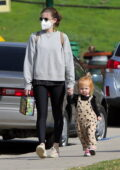 Kate Mara wears a grey sweatshirt and black leggings while out for stroll with her daughter in Silver Lake, California