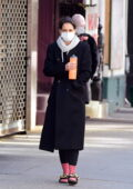 Katie Holmes bundles up in a trench coat, grey hoodie and pink socks while out in New York City
