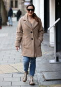 Kelly Brook bundles up in a warm coat as she arrives at Heart Radio in London, UK