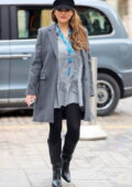 Kelly Brook looks fashionable in a grey coat, black tights and knee-high boots as she arrives at Heart radio in London, UK