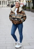 Kelly Brook looks great in puffer jacket and tight denim as she arrives at Heart radio in London, UK