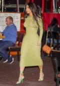 Kim Kardashian looks fab in a body-hugging green dress as she enjoys a girls night out at Matsuhisa in Beverly Hills, California