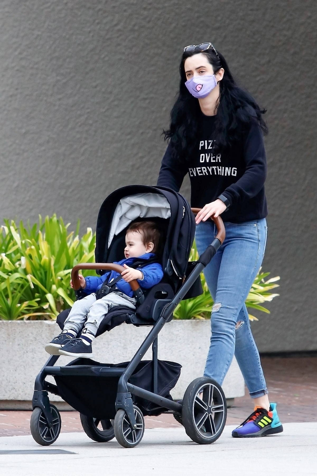 Krysten Ritter takes her son to a Toy Shop while out for a stroll in Los Angeles