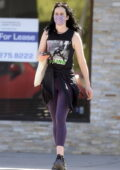 Krysten Ritter visits her tailor after working out in a sleeveless tee and purple leggings in Los Angeles