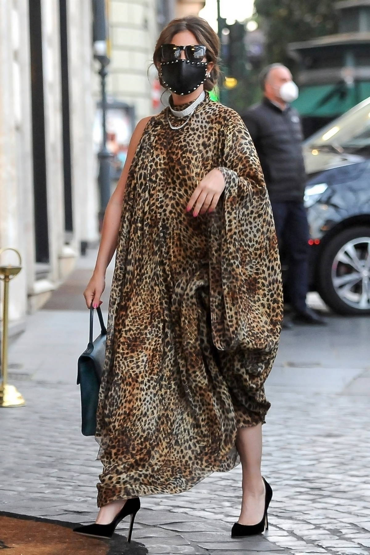 Lady Gaga looks fashionable in a leopard print dress as she arrives back to her hotel in Rome, Italy