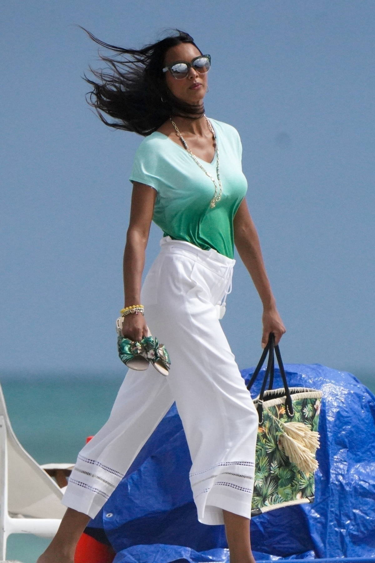 Lais Ribeiro stands out in green during a 'Tropical Inspired' photoshoot on the beach in Miami, Florida