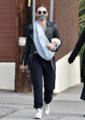Lucy Hale brings along her new puppy on a sling while out for lunch with a friend in Studio City, California