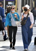 Lucy Hale carries her little pup on a sling as she steps out for coffee with a friend in Los Angeles