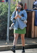 Lucy Hale carries her new pup on a sling while out shopping in Venice, California