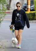 Lucy Hale collects some packages before taking her dog on another walk in Los Angeles