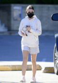 Lucy Hale keeps it comfy in a white hoodie and shorts while heading to Alfred's Coffee in Los Angeles