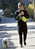 Lucy Hale keeps things casual in black sweatsuit as she takes a walk with her pup Elvis in Los Angeles