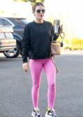 Lucy Hale seen arriving for a Pilates session wearing a black sweatshirt and pink leggings in Los Angeles