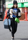Lucy Hale seen carrying her newly adopted puppy as she heads to the gym in Los Angeles