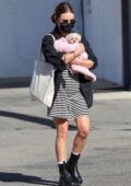 Lucy Hale cradles her newly adopted puppy in Studio City, California