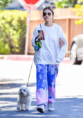 Lucy Hale seen wearing colorful tie-dye sweatpants as she takes her morning walk with her dog in Studio City, California