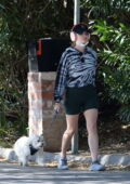 Lucy Hale steps out in tight workout shorts and tie-dye hoodie for a hike with her dog Elvis in Studio City, California