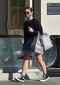 Lucy Hale wears a black sweatshirt and denim skirt while shopping for art supplies at Michaels in Studio City, California