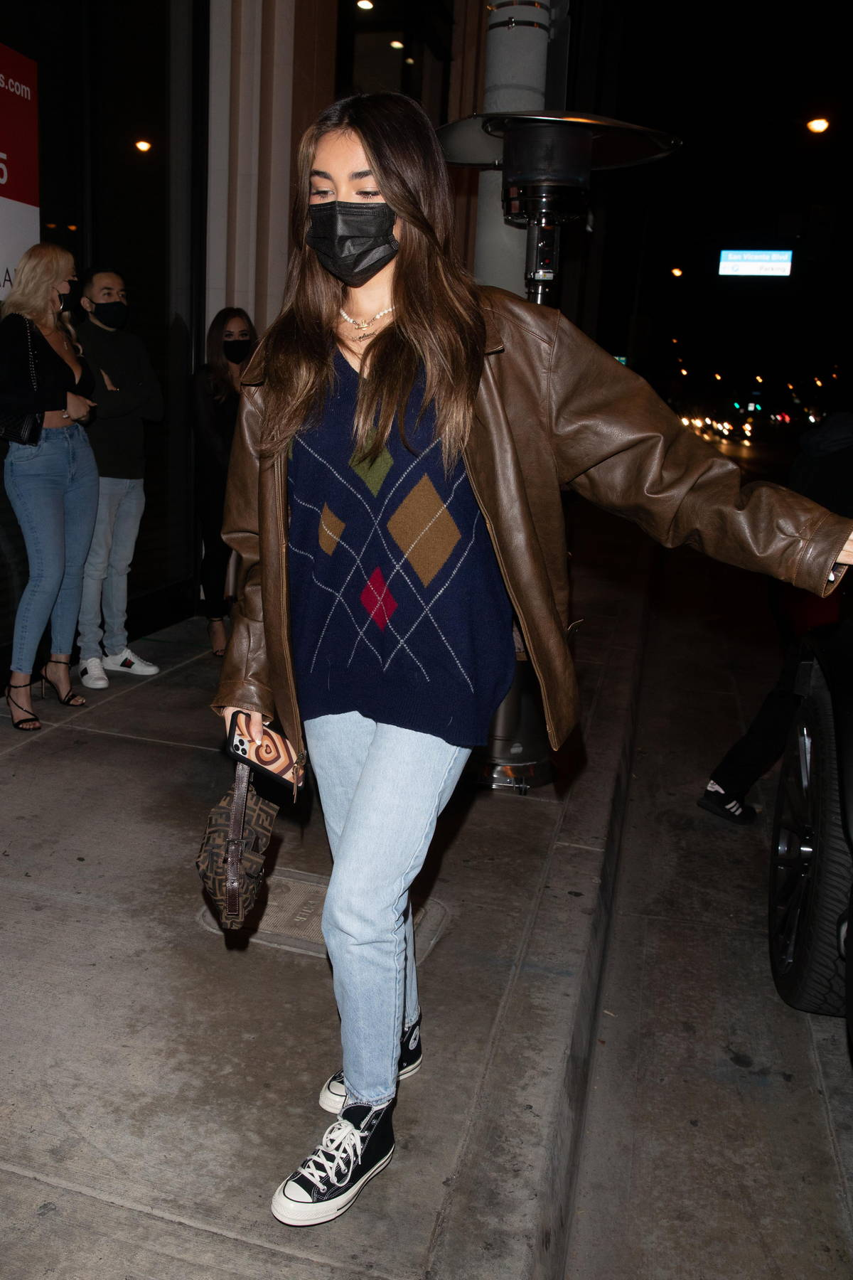 Madison Beer sports a brown leather jacket with a sweater as she arrives for dinner at Catch LA in West Hollywood, California