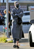 Mandy Moore covers her baby bump while visiting a friend's house in Los Angeles