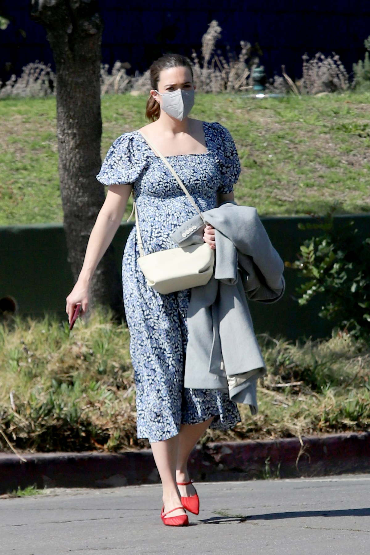 Mandy Moore shows her baby bump as she steps out wearing floral print blue dress and red flats in Los Angeles