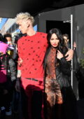 Megan Fox and Machine Gun Kelly hold hands as they leave their hotel in New York City