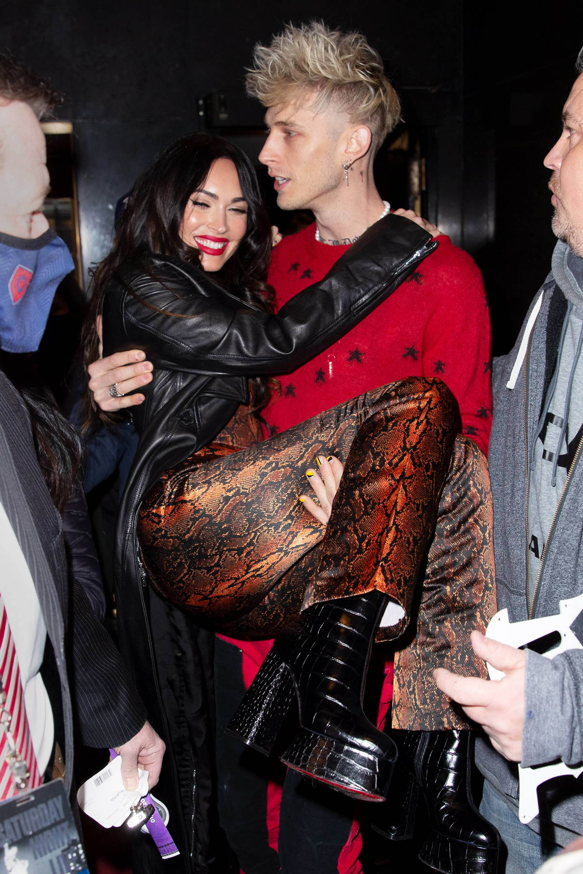 Megan Fox is all smiles as Machine Gun Kelly carries her in his arms while heading into SNL studios in New York City