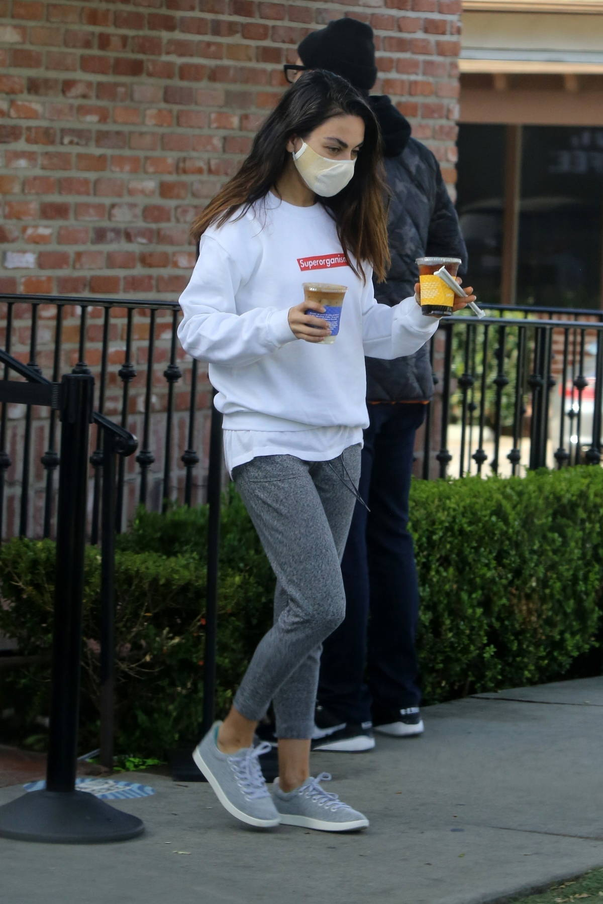 Mila Kunis keeps it cozy in sweatshirt and joggers as she picks up coffee in Los Angeles