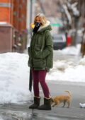 Naomi Watts bundles up as she steps out to walk her dog in New York City