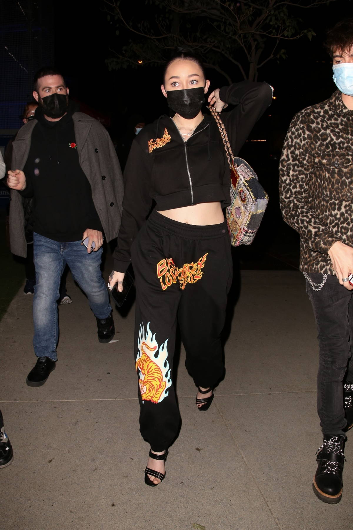 Noah Cyrus seen wearing sweatsuit as she arrives at BOA Steakhouse with Lucas Machado in West Hollywood, California