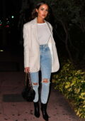 Olivia Culpo looks chic in a white blazer paired with matching top and ripped jeans during a dinner outing in Miami, Florida