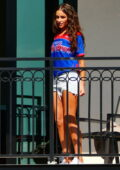 Olivia Culpo seen relaxing in a jersey and denim shorts before Shaq Bowl in Tampa Bay, Florida