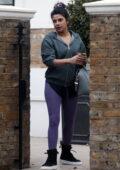 Priyanka Chopra sports a hooded jacket and purple leggings as she leaves her home in London, UK