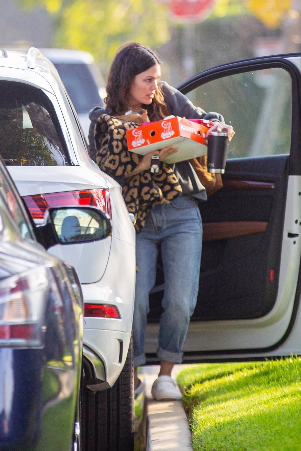 Rachel Bilson has her hands full while arriving at a Super Bowl party with a box from Randy's Donuts in Los Angeles