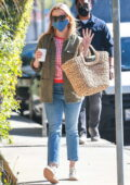 Reese Witherspoon heads back home after lunch at the Brentwood Country Mart in Brentwood, California
