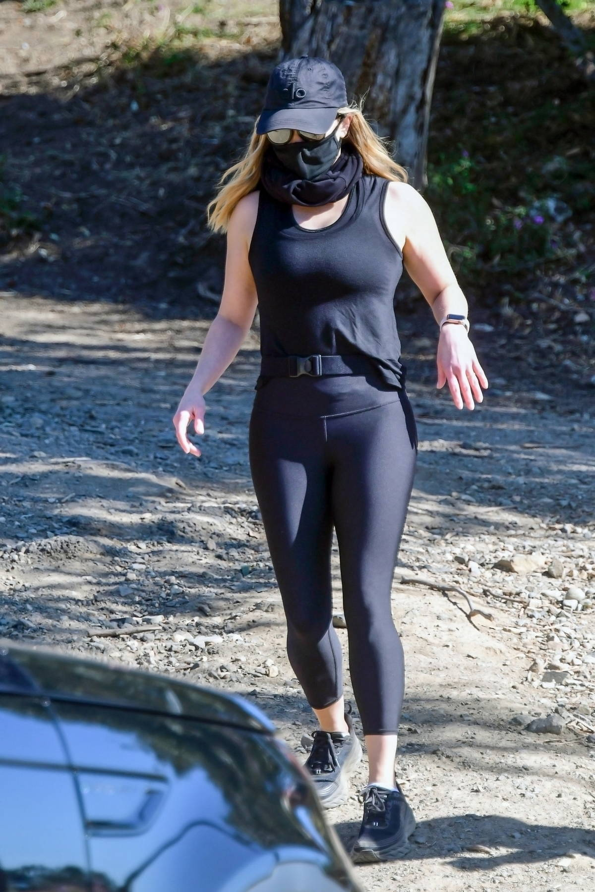 Reese Witherspoon sports black tank top and leggings during a morning hike with a friend in Los Angeles